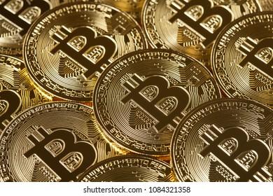Many shiny golden bitcoins