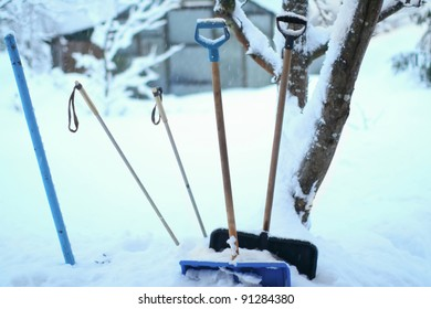 Many shovels and skiing equipment are stuck in very high snow on winter days