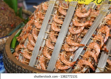 Many shrimp are skewer into wooden sticks.Food of southern Thailand people.local food