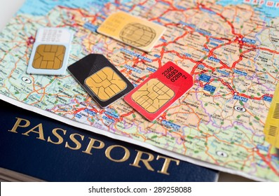 many sim cards with the europe map on background of a passport