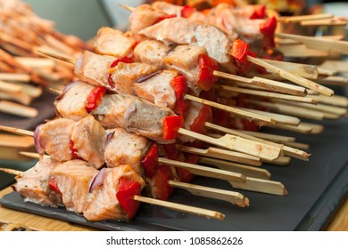 Many skewers with fish and pepper. Catering food. Snacks and appetizers.