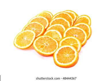 Many sliced oranges isolated on white