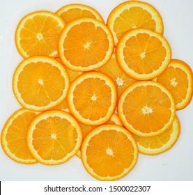 Many slices of orange on a white background.