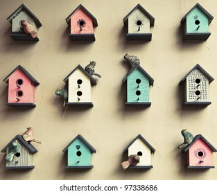 many small birdhouses background