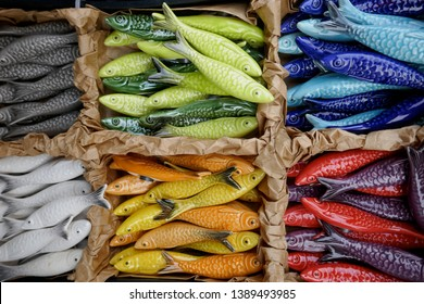 Many small ceramic fishes, pretty travel souvenirs as decoration objects.  (no recognizable mark, logos, no reference to the manufacturer and is therefore not copyrighted)