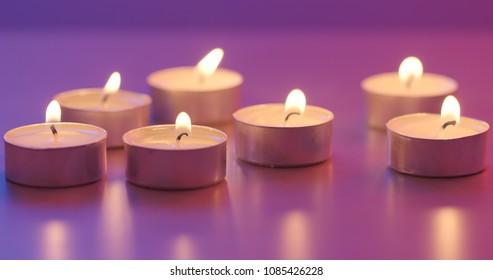 Many small flaming candles burning