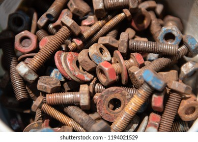 Many small and large parts of the old mixed with the rust. Parts and new empty campsites. bolts nuts rusty.