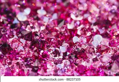 Many small ruby diamond stones, luxury background shallow depth of field