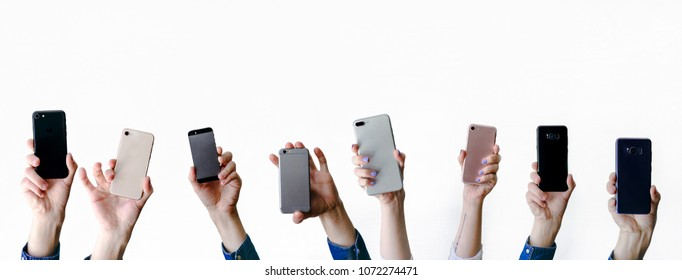 many smartphones in group of people's hands isolated on white background facebook cover