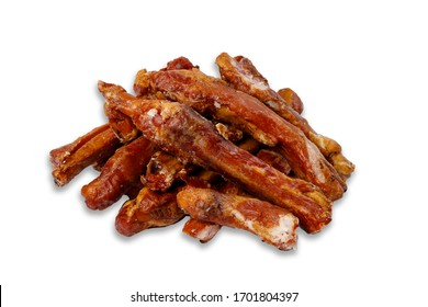 many smoked ribs stacked on top of each other. side view on a white background