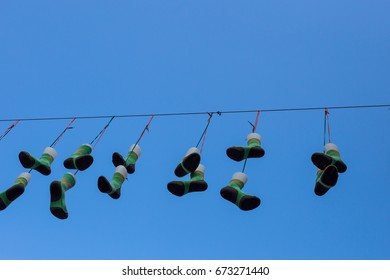 Many socks hanging on a line against blue sky.  Four Days March (vierdaagse) in Nijmegen, The Netherlands. Juli 2017.