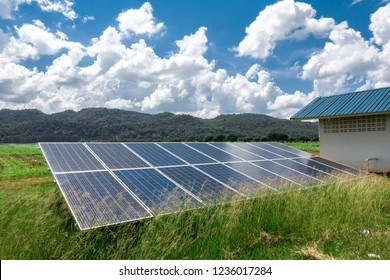 Many solar panels Installed at the foot of the mountain. On a clear day, and there are many clouds.