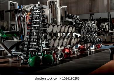 many sports equipment in gym room interior, horizontal photo
