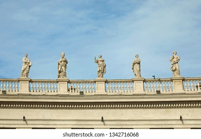 many statues above the Bernini colonnade in St. Peter's Square in the Vatican City