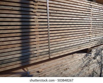 many stocked wooden planks for a construction
