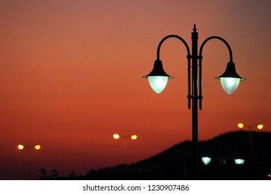 Many of streetlamp at sunset