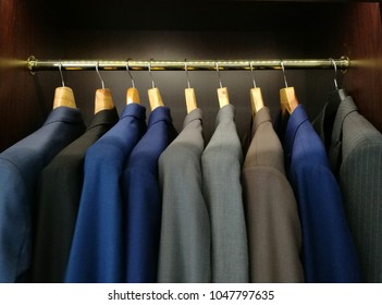 Many Suit hang in the closet