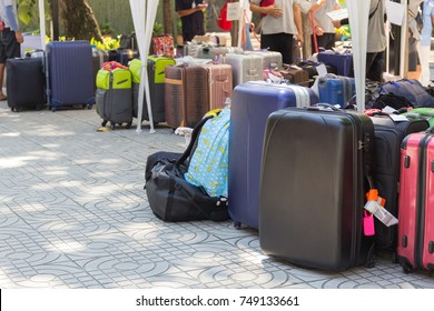 Many suitcase bags travel group tour, business travel on hotel background.