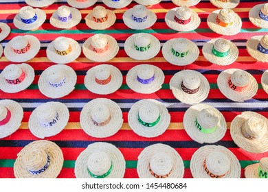 Many summer hats made of sisal ropes as souvenirs