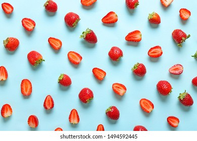 Many sweet ripe strawberry on color background
