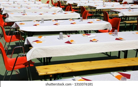 many tables and chairs outside during the village party
