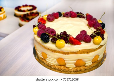 Many tasty cakes with fruits on the kitchen