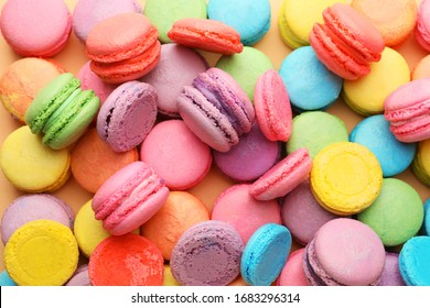 Many tasty macarons as background
