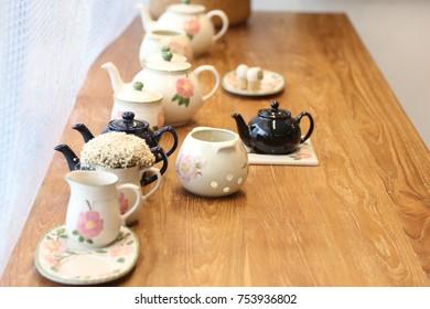 many tea pots on the table