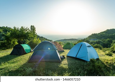 Many tents in the mountain.. Outdoor concept. Sunshine morning in the forest.