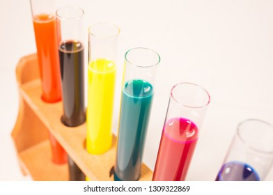 many test tubes filled with fluids of various colors