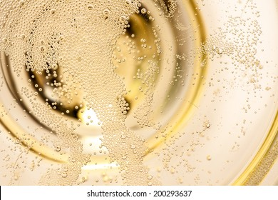 Many tiny bubbles in a champagne glass