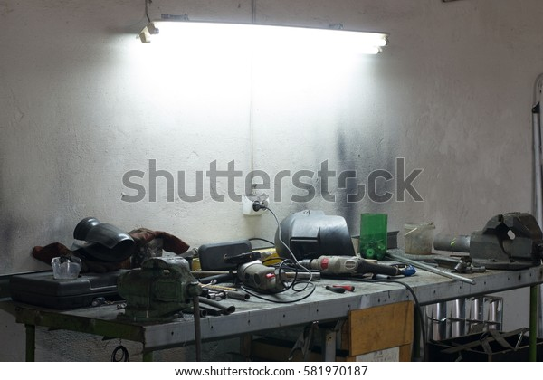 Many tools lying on a table in the garage