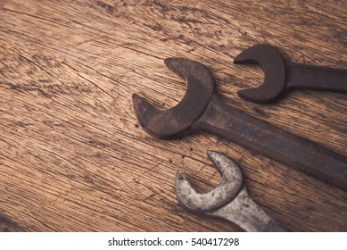Many Tools on wooden background.