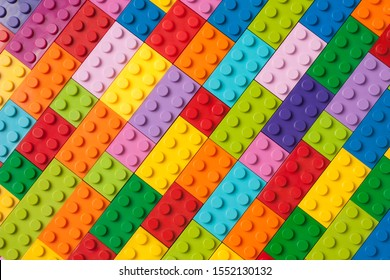 Many toy blocks in different colors making up one large square shape in top view. Toys and games. Leisure and recreation. - Shutterstock ID 1552130132
