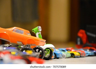 many toy cars in line