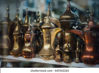 Many traditional antique Arabic coffee pots knows as Dallah, displyed in a shop in the souk.