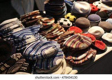 many traditional jewish headwears - the Kippah Offered for sale at the Israeli market - Mahane Yehuda, Jerusalem - selective focus