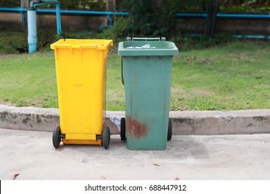 many trash can near the road