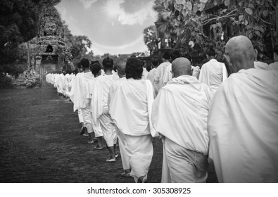 Many unidentified Buddhist nuns in white suit walking for celebrate Buddhist Sabbath at Angkor wat in Siem Reap, Cambodia black and white tone