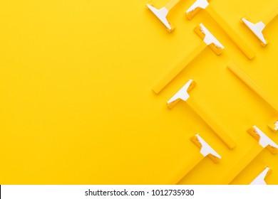 many unisex razors on the yellow background