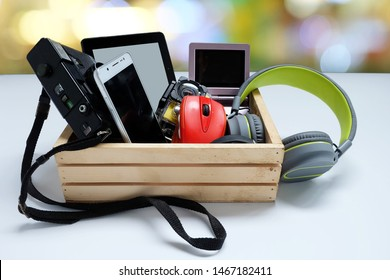 Many used modern Electronic gadgets for daily use in wooden cases on white background, Reuse and Recycle concept