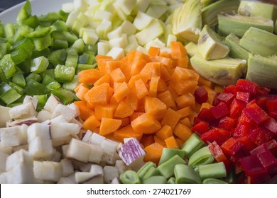 Many vegetables cut on dices on a plate