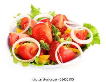 many vegetables on the plate isolated on white