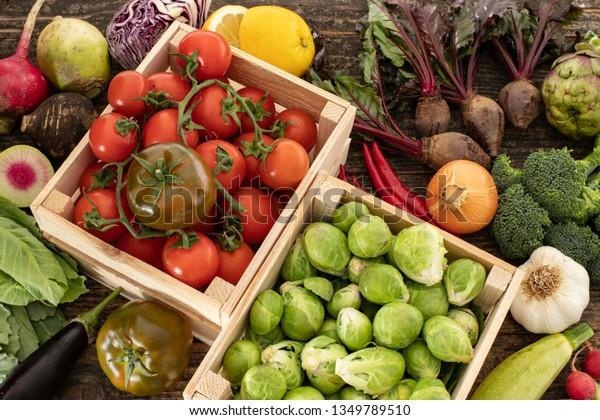 Many vegetables in the wooden trunks.