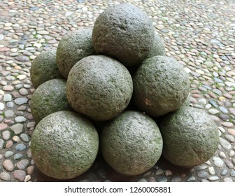 many very ancient cannonballs made with stones