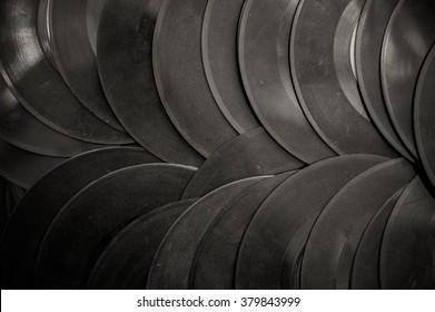 Many vintage 45s vinyl background in black and white