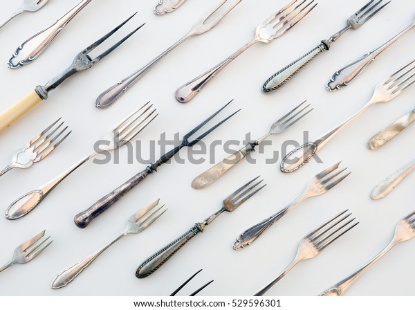 many vintage forks  - old cutlery , beautiful retro flatware - food concept