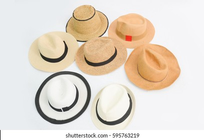 Many vintage hat with a ribbon on white background