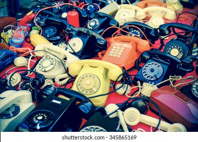 Many vintage phones retro style photo