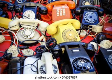 Many vintage phones retro style photo